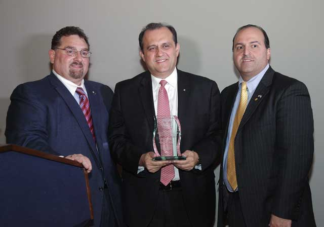 AHI President Nick Larigakis (center) receives the 2012 AHEPA Outstanding Public Advocacy Award from AHEPA Executive Director Basil Mossaidis (left) and AHEPA Supreme President Dr. John Grossomanides (right).